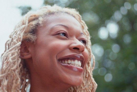 Smiling Woman With Blond Dreadlocks